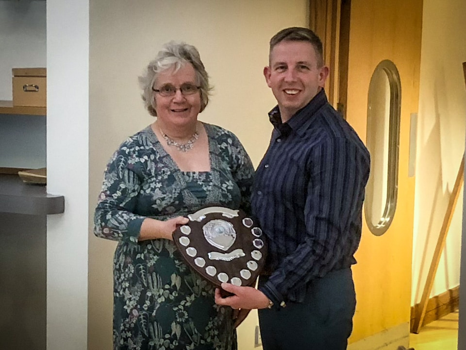Sue Dors presents Marc Newman with Western Counties ASA Open Water Swimmer of 2016